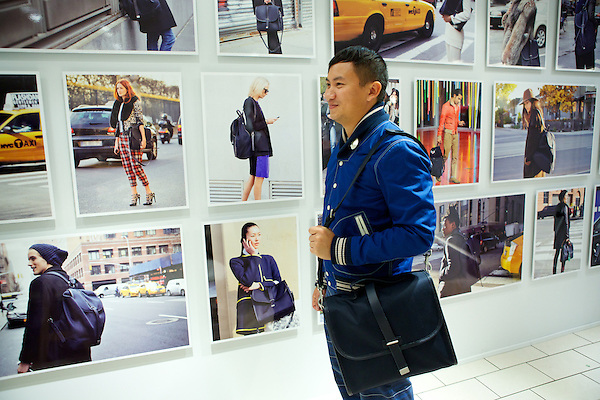 Tommy Ton wears his Club Monaco bag