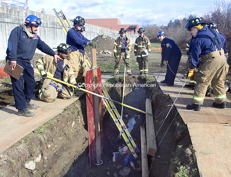 WATERB URY CT.-18 NOVEMBER 2010 111810DA01- Waterbury Fire Capt. Steve Venezizno, left, an expert in trench training instructs Waterbury firefighters during a training session on rescuing people from a trench collapsed accident.<br /> Darlene Douty Republican American