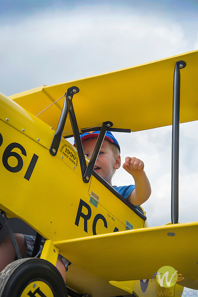 Toddler boy in toy biplane. Eagles Mere Air Museum.