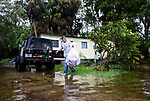 SAINT MARKS, FL - OCTOBER 10: Mitchell Pope tries to salvage what he can from his mobile home as Hurricane Michael pushes the storm surge up the Wakulla and Saint Marks Rivers which come together here on October 10, 2018 in Saint Marks, Florida. (Photo by Mark Wallheiser/Getty Images)