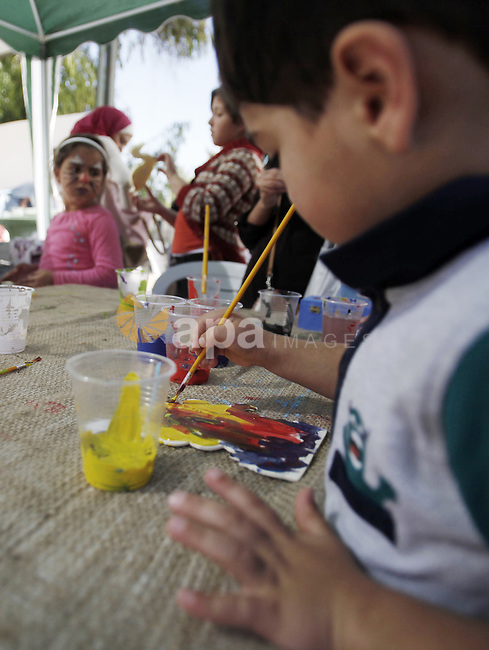 Palestinians take part in the annual Jerusalem's cakes festival in the east Jerusalem neighborhood of Sheikh Jarrah, Oct. 27, 2013. The Jerusalem's cakes festival is an annual carnival that inviting Palestinian children, students and adults alike to enjoy music, plays, handmade products exhibitions, and flavors of Jerusalem cakes and sweets during a one day festival. Photo by Saeed Qaq