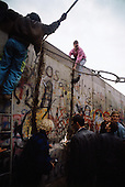 West Berlin, West Germany<br /> November 11, 1989<br /> <br /> West Germans pull down a section of the Berlin Wall. The East German government lifts travel and emigration restrictions to the West on November 9, 1989.