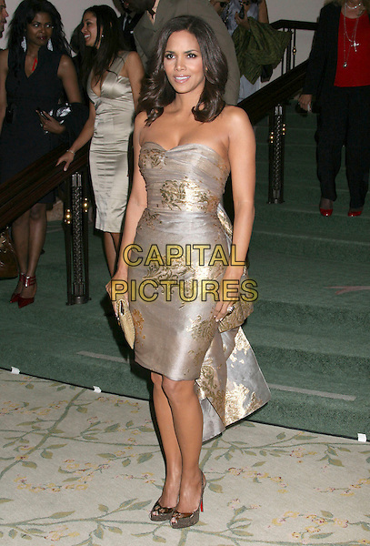 HALLE BERRY .Hosts the ESSENCE Black Women in Hollywood Luncheon held at The Beverly Hills Hotel, Beverly Hills, CA, USA, 19th February 2009..full length strapless gold silver patterned print metallic dress beige clutch bag Christian Louboutin cork platform shoes .CAP/ADM/KB.©Kevan Brooks/Admedia/Capital PIctures