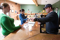 1/2/2011-  Todd Bostock pours a glass of wine for Amy Close in the tasting room at Dos Cabezas Wineworks, in Sonoita, Arizona. (Photo by Pat Shannahan)