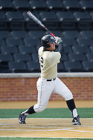 Joe Napolitano (12) of the Wake Forest Demon Deacons follows through on his swing against the Marshall Thundering Herd at Wake Forest Baseball Park on February 17, 2014 in Winston-Salem, North Carolina.  The Demon Deacons defeated the Thundering Herd 4-3.  (Brian Westerholt/Four Seam Images)