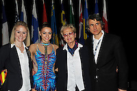 (L-R) Caroline Hunt (USA - FIG RG TC Member); Evgeniya Kanaeva (RUS); Tamara Bompa (CAN - CJP); Jean-Paul Caron (CAN - President and CEO Canada Gymnastics) pose for photo at World Cup Montreal on January 31, 2010.  (Photo by Tom Theobald).
