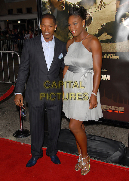"JAMIE FOXX, SERENA WILLIAMS.attends The Universal Pictures' World Premiere of ""The Kingdom"" held at Mann's Village Theatre in Westwood, California, USA, September 17 2007.                                                                      full length grey dress black suit.CAP/DVS.©Debbie VanStory/Capital Pictures"