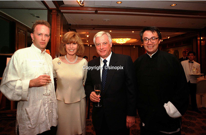 260697:  MANDARIN RECEPTION: HONG KONG<br /> (From right to left)<br /> SSM (Sunday Times reporter), Stephanie Powers, Chris Patten, David Tang at the Mandarin Oriental Hotel, Hong Kong.