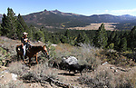 Cami Chavez rides a trail to Scotts Lake above Hope Valley, Ca. near South Lake Tahoe on Wednesday, Oct. 13, 2010. .Photo by Cathleen Allison