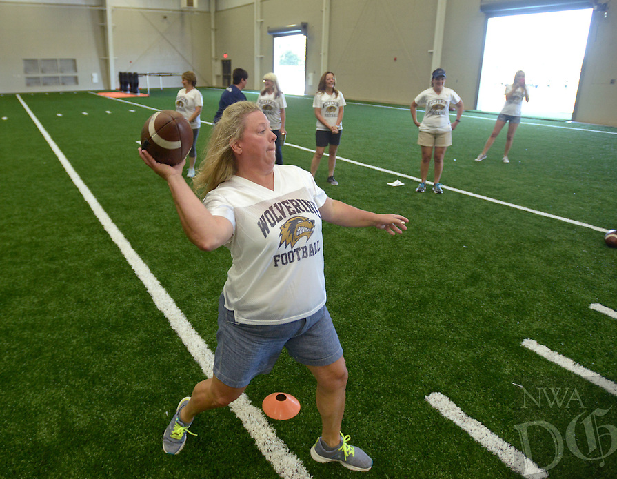 NWA Democrat-Gazette/BEN GOFF @NWABENGOFF<br /> Moms and female relatives of Bentonville West football players learn more abou the game on Sunday Aug. 21, 2016 during Wolverine Helmets and Heels at Bentonville West High School in Centerton.