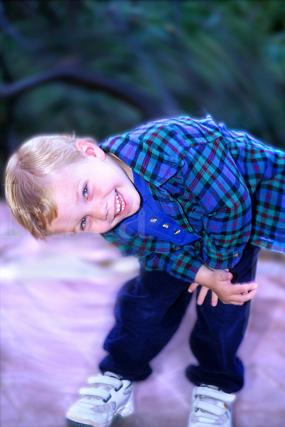Blond hair and blue eyed child playing with motion and  photographer. (Number 1 of a series.