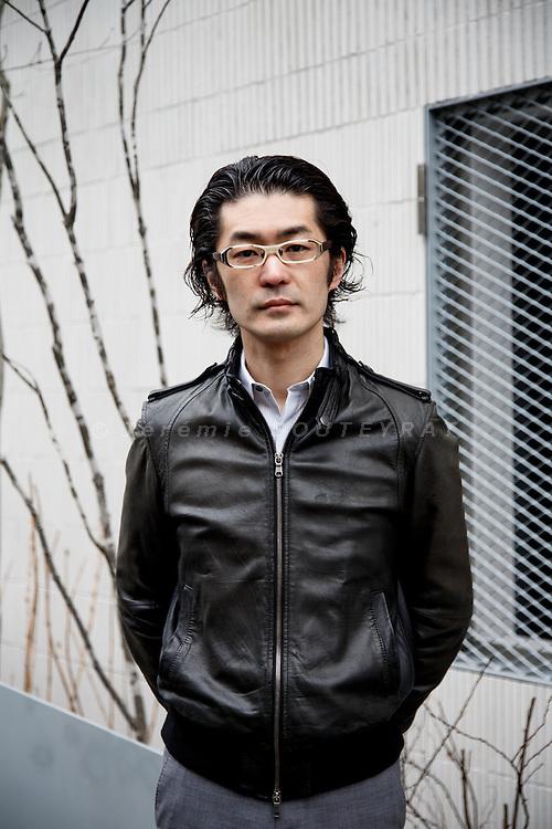 Tokyo, February 24 2014 - Portrait of Japanese architect Makoto Yamaguchi in front of oggi, a residence he designed in the Otsuka area.