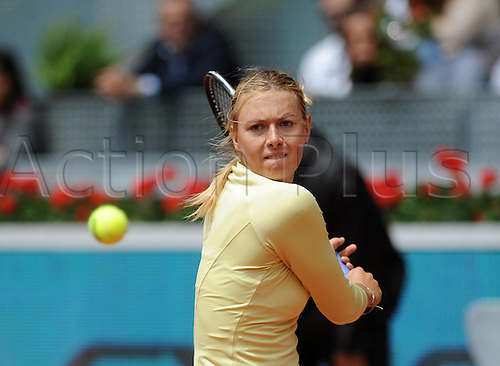 09 05 2010   Madrid.  Sharapova of Russia Returns A Ball to Lucia Safarova of Czech Republic during their First Round Match AT The Madrid WTA Tennis Open in Madrid Spain ON May 9 2010 Sharapova Lost 0 2