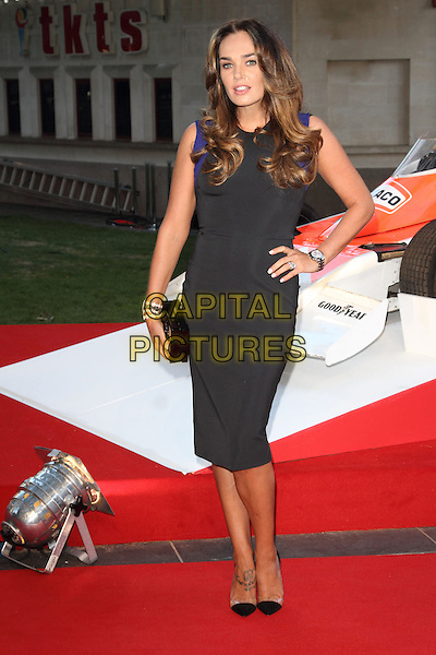 Tamara Ecclestone<br /> The World Premiere of 'Rush' at the Odeon Leicester Square, London, England.<br /> September 2nd, 2013<br /> full length black sleeveless dress clutch bag hand on hip<br /> CAP/ROS<br /> &copy;Steve Ross/Capital Pictures
