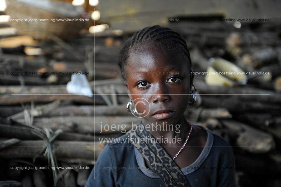 Sierra Leone, Freetown, girl sells firewood