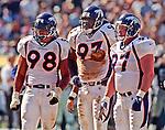 Oakland Raiders vs. Denver Broncos at Oakland Alameda County Coliseum Sunday, September 20, 1998.  Broncos beat Raiders  34-17.  Denver Broncos defensive end Maa Tanuvasa (98), defensive tackle Trevor Pryce (93) and nose tackle Mike Lodish (97).