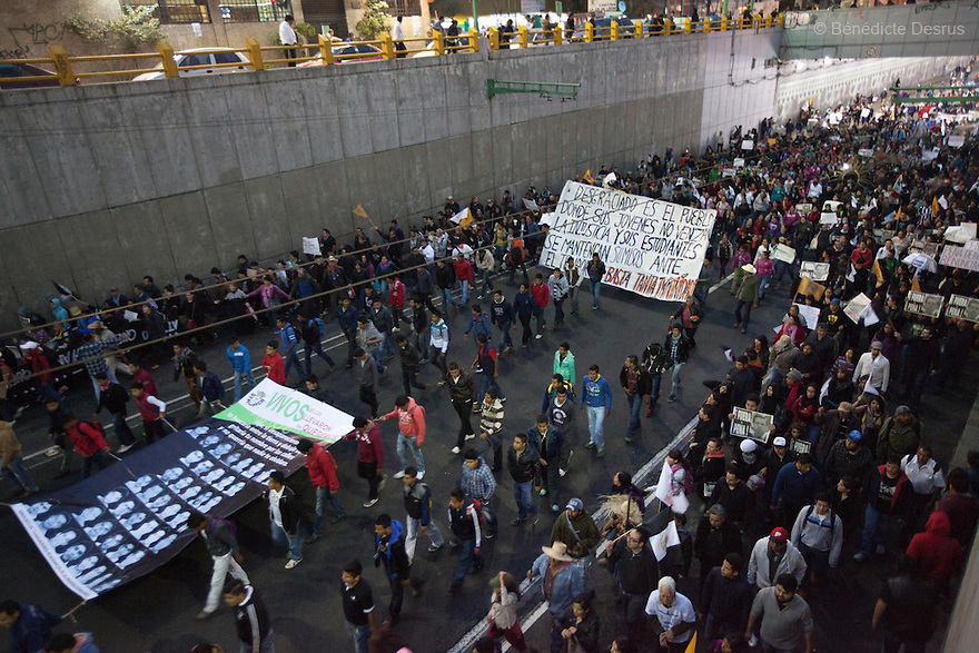Tens of thousands protest march in support of the 43 missing Ayotzinapa's students, on a day normally reserved for the celebration of Mexico's 1910-17 Revolution, in Mexico City, Mexico on November 20, 2014. Parents of the 43 missing students still do not believe the official line that the young men are all dead. Criticism of the government has intensified in Mexico and the country has been convulsed by protests. Many are demanding justice and that the search for the 43 missing students continue until there is concrete evidence to the contrary. Mexico officially lists more than 20 thousand people as having gone missing since the start of the country's drug war in 2006, and the search for the missing students has turned up other, unrelated mass graves.(Photo by BénédicteDesrus)