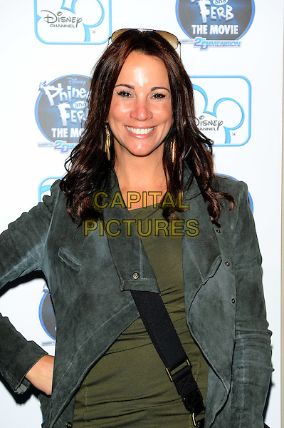 "Andrea McLean  .At the UK premiere of Disney's ""Phineas and Ferb the Movie: Across the 2nd Dimension"" at Appollo Picadilly, London, England..24th September 2011.half length black jacket green top hand on hip.CAP/CJ.©Chris Joseph/Capital Pictures."