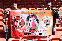 Fleetwood Town fans show off a flag<br /> <br /> Photographer Richard Martin-Roberts/CameraSport<br /> <br /> The EFL Sky Bet League One - Blackpool v Fleetwood Town - Saturday 14th April 2018 - Bloomfield Road - Blackpool<br /> <br /> World Copyright &not;&copy; 2018 CameraSport. All rights reserved. 43 Linden Ave. Countesthorpe. Leicester. England. LE8 5PG - Tel: +44 (0) 116 277 4147 - admin@camerasport.com - www.camerasport.com