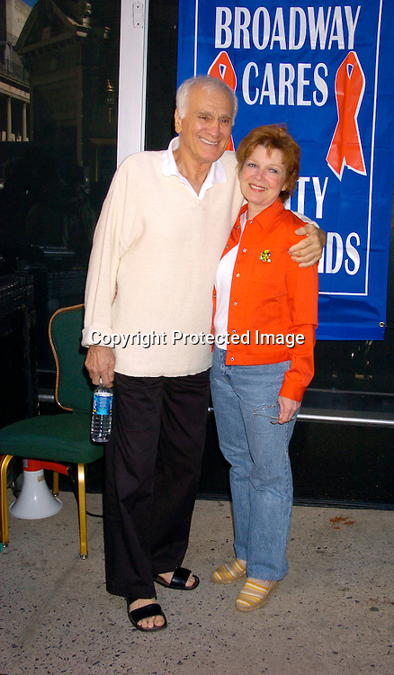 Dick Latessa and Anita Gillette..at the Broadway Cares/ Equity Fights Aids Flea Market and Grand Auction on September 19, 2004 in Shubert Alley...Photo by Robin Platzer, Twin Images