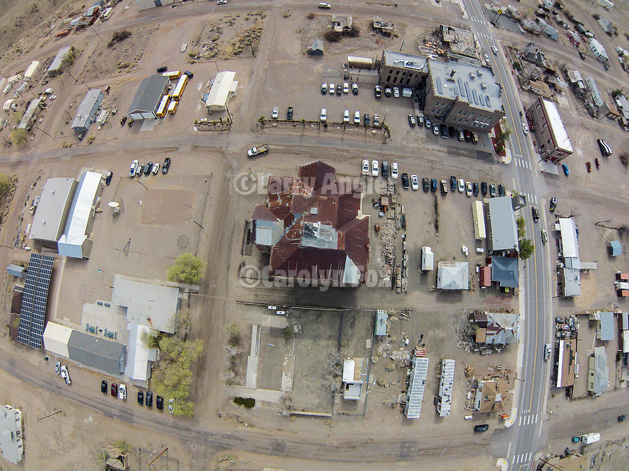 Historic Goldfield High School and downtown from the air, Nev.<br /> <br /> To the left is the Goldfield Elementary School, upper right is the Esmeralda County Courthouse. and old fire house, both along U.S. Highway 95.