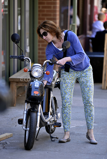WWW.ACEPIXS.COM....April 27 2013, New York City......Actress Edie Falco sports a new red hair color as she rides her electric scooter around Tribeca on April 27 2013 in New York City......By Line: Curtis Means/ACE Pictures......ACE Pictures, Inc...tel: 646 769 0430..Email: info@acepixs.com..www.acepixs.com