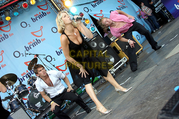 BANANARAMA - SARA DALLIN .Performs live in concert at 96.4 BRMB's Party In The Park, Cannon Hill Park, Birmingham, .July 3rd 2005..full length stage black dress gig cleavage breasts boobs low cut.Ref: JEZ.www.capitalpictures.com.sales@capitalpictures.com.©Jez Self/Capital Pictures