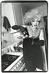 Late 1980's:   A portrait of drag queen DJ Dinah in the kitchen of her apartment in New York City.
