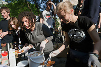 Moscow, Russia, 15/05/2012..Protesters serve vegan food at a makeshift kitchen in Chistiye Prudy, or Clean Ponds, as a Moscow court ordered the eviction of some 200 opposition activists who have set up camp in the city centre park.