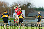 Liam Kearney and Ronan Buckley, East Kerry in action against Johnny Buckley, Dr Crokes during the Kerry County Senior Club Football Championship Final match between East Kerry and Dr. Crokes at Austin Stack Park in Tralee, Kerry.