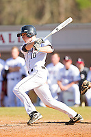 Forrest Brandt #10 of the Davidson Wildcats follows through on his swing against the College of Charleston Cougars at Wilson Field on March 12, 2011 in Davidson, North Carolina.  The Wildcats defeated the Cougars 8-3.  Photo by Brian Westerholt / Four Seam Images