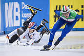 01 February 2019, Saxony, Dresden: Shorttrack: World Cup, quarter finals, 1500 meter men in the EnergieVerbund Arena. Tobias Pietzsch (l) from Germany falls with  Gun Woo Kim (M) from Korea and Andrea Cassinelli (r) from Italy.