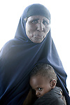 HABASWEIN, KENYA - JULY 4: Mohammedek Siyad, 21 months old, waits with his grandmother to be admitted at  the hospital on July 4, 2011 in Habaswein, Kenya. The boy was referred to the hospital from Mathahalibah location, where Save the Children outreach workers come once a week to check the children in the area. Mohammedek's grandmother Habiba Sahal came with him to the outreach site to receive some food and medicine. His mother left three months ago with their remaining livestock. Forced away due to the sever drought in the area. She is expected back when rain falls again. Mohammedek is now being cared by his grandmother. Two successive poor rains, entrenched poverty and lack of investment in affected areas have pushed millions of people into a fight for survival in the Horn of Africa. This is the driest this area have been since sixty years. (Photo by Per-Anders Pettersson)