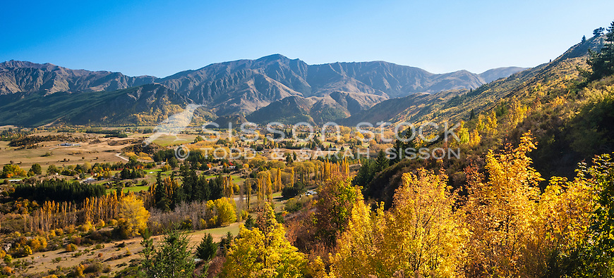 Autumn colour from the Crown Range road looking down to Wakatipu Basin and Arrowtown, South Island, New Zealand - stock photo, canvas, fine art print