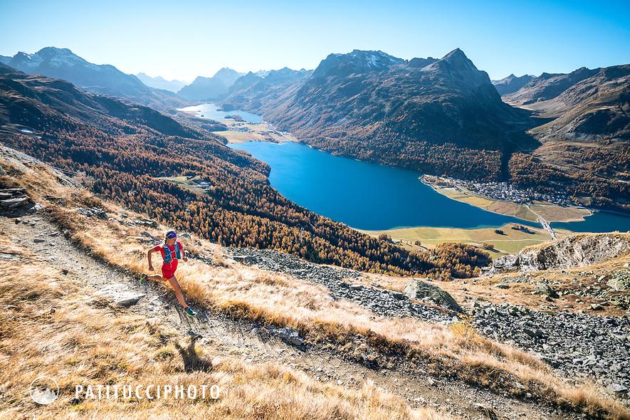 Trail running above the Lej da Silvaplana (Silvaplana Lake), near St. Moritz, Switzerland