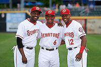 Harrisburg Senators Isaac Ballou (9), Wilmer Difo (6), and Rafael Bautista (12) pose for a photo during warmups before a game against the New Hampshire Fisher Cats on June 2, 2016 at FNB Field in Harrisburg, Pennsylvania.  New Hampshire defeated Harrisburg 2-1.  (Mike Janes/Four Seam Images)