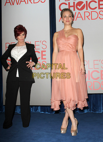 Sharon Osbourne & Kaley Cuoco.People's Choice Awards 2012 Nominees Announcement Held At The Paley Center for Media, Beverly Hills, California, USA..November 8th, 2011.full length black trousers jacket white top suit pink one shoulder dress gold shoes hands on hips funny tall short.CAP/ADM/KB.©Kevan Brooks/AdMedia/Capital Pictures.