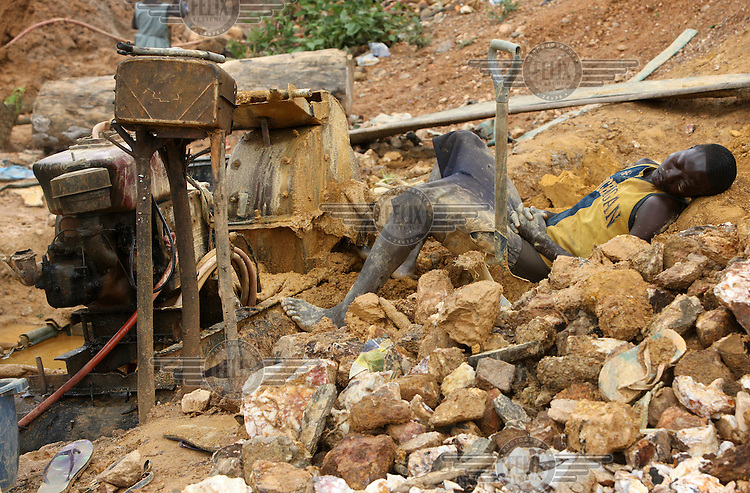A young man takes a rest on a gold mining site in Obuasi. Many unemployed young people have taken to working as illegal artisanal gold miners known as galamseys in Ghana.