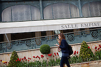 Stefanie A (wearing jeans) and Diana Basfam, students of the International University of Monaco, walk by l'Hotel de Paris in Casino Square, Monte Carlo, Monaco, 19 April 2013