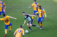 Luke O'Nien of Wycombe Wanderers takes on 5 Mansfield players during the Sky Bet League 2 match between Wycombe Wanderers and Mansfield Town at Adams Park, High Wycombe, England on 25 March 2016. Photo by Andy Rowland.