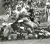 Bills O.J. Simpson is stopped by a host of Oakland Raider's. 1972 NFL game between the Buffalo Bills and the Raiders. photo by Ron Riesterer