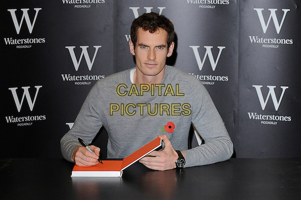 LONDON, ENGLAND - NOVEMBER 06: Andy Murray signs his book 'Seventy-Seven: My Road To Wimbledon Glory' at Waterstones, Piccadilly on November 6th 2013 in London, England.<br /> CAP/BEL<br /> &copy;Tom Belcher/Capital Pictures