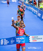 31 MAY 2014 - LONDON, GBR - Mario Mola (ESP) of Spain beats Richard Murray (RSA) of South Africa  to the finish line to win the men's 2014 ITU World Triathlon Series round in Hyde Park, London, Great Britain (PHOTO COPYRIGHT © 2014 NIGEL FARROW, ALL RIGHTS RESERVED)