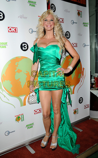 SARAH BURGE.The HumanHi Launch Party, Biagio Ristorante, Piccadilly, London, England..May 21st, 2008.full length Real life Barbie green silk satin dress cleavage train bows open toe shoes silver hand on hip strapless .CAP/CAN.©Can Nguyen/Capital Pictures.