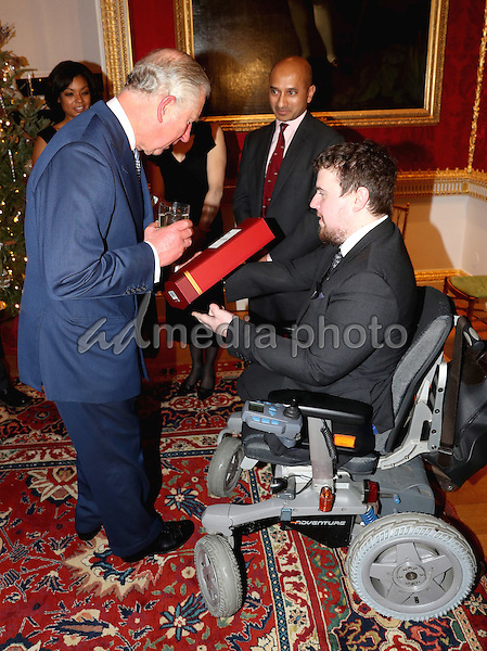 14 December 2016 - Prince Charles, Prince of Wales is presented with whisky by Matt Weston at the Style for Soldiers Christmas Reunion Party at Spencer House in London. The Prince of Wales met injured servicemen and women who have been helped by the charity, and others who have supported them. His Royal Highness will also meet some of the charity's patrons and ambassadors. Photo Credit: Alpha Press/AdMedia