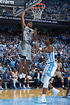 Doral Moore (4) of the Wake Forest Demon Deacons goes up for a slam dunk over Brandon Huffman (42) of the North Carolina Tar Heels during first half action at the Dean Smith Center on December 30, 2017 in Chapel Hill, North Carolina.  The Tar Heels defeated the Demon Deacons 73-69.  (Brian Westerholt/Sports On Film)