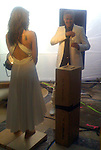 .www.abilityfilms.com 805-427-3519.abilityfilms@yahoo.com.5-1-08 Exclusive.Day 2 George Clooney on the set of a Martini and Rossi commercial.  The other leading character is actress Shannyn Sossamon pictured from the back in the white dress. The shoot was at a mansion in Beverly Hills that belongs to the owner of Clear Channel and has been sponsored by Dolce and Gabbana, hence Clooney dressed in D & G from head to toe. Notice the mustache on Clooney, a finely groomed pencil stasch. The girl wearing black posing with George was also in the commercial. Don't know her name.