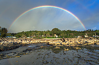 A double rainbow shines above Shark's Cove at low tide, North Shore, O'ahu.