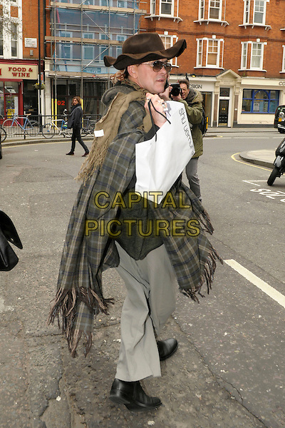 Steve Strange .leaving BBC Radio 2 London, England, UK, 21st March 2013..full length brown hat checked wrap shawl scarf sunglasses back rear behind talking on mobile phone grey trousers Shu Uemura carrier bag poncho tartan plaid .CAP/IA.©Ian Allis/Capital Pictures.