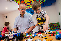 Friday  12 August 2016<br /> Pictured:  Amazon manager Pat Faulkner with one of the Carmarthen Breakthro children Lewis Powell Re: The Amazon team in Swansea has made a recent donation of £1,000 to Carmarthen Breakthro charity. The Amazon team are visited the charity to learn more about what they do and how they plan to use the money.